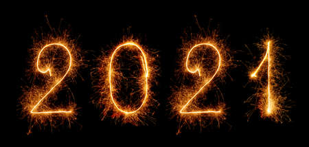 Sparkling lettering 2021 with sparklers isolated on black background