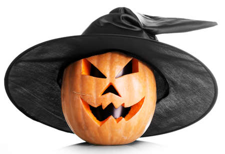 Handmade jack-o-lantern head with black eyes in a cap isolated on white background