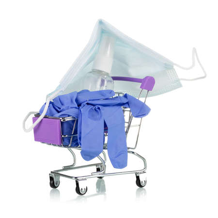 Concept of the need to buy personal protective equipment and antiseptics during the covid-19 pandemic. Shopping cart isolated on white background