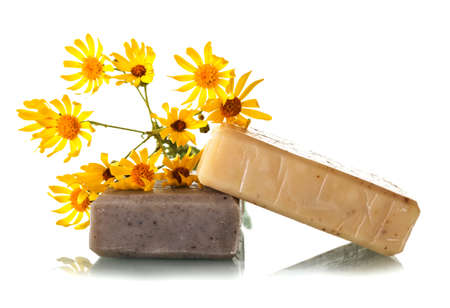 Natural handmade soap with useful herbs and chamomile isolated on white background