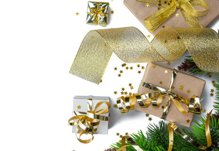 New year craft gifts with gold ribbon, serpentine, christmas branches and stars confetti isolated on white background Standard-Bild