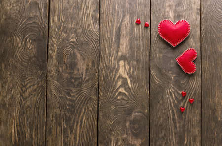 Valentine's day card in minimal style. Two red hearts and small decor on gray boards with a place for writing Standard-Bild