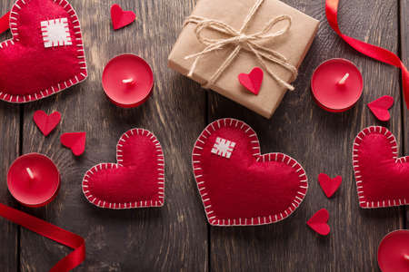 Valentine's day card. Hearts, boxes and ribbons on a background of boards. Top view Standard-Bild