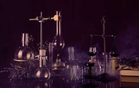 Ominous laboratory of witchcraft and magic on a dark background