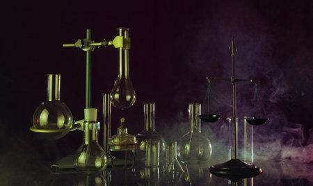 Fantastic chemical laboratory with smoke effect on dark background Archivio Fotografico
