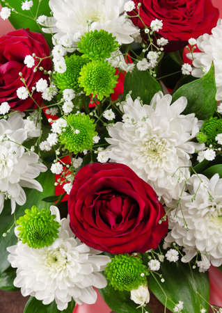 Top view. Close up. Bouquet of bright spring flowers of roses and chrysanthemums