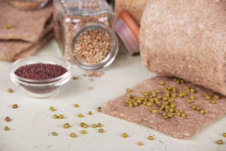 Microgreen growing illustration. Linen mat, seeds on a light background