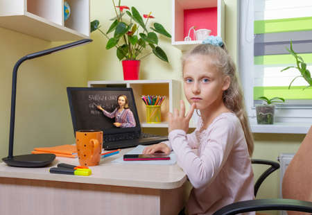 The girl pondered a difficult example. Online learning using a laptop from home