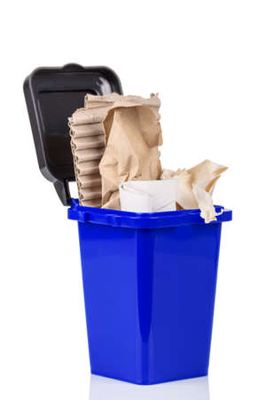 Household waste sorting concept. Blue trash bin with paper trash isolated on white background Archivio Fotografico