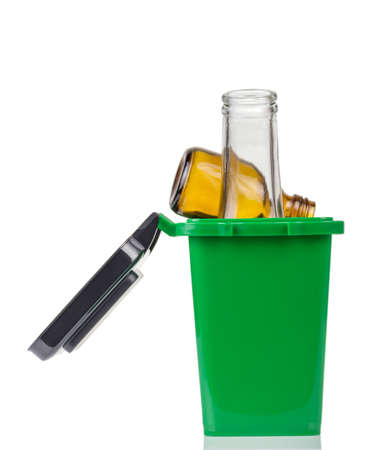Household waste sorting concept. Green trash bin for glass rubbish bottles isolated on white background Archivio Fotografico