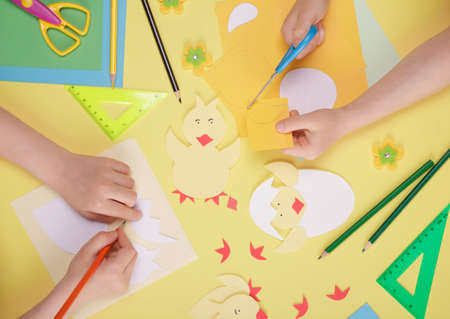 Children's creativity. Craft paper, scissors, pencils, and other stationery. Top view