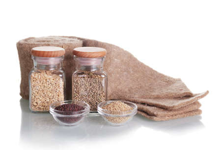 Set for growing microgreens. Seeds in glass jars, linen mat isolated on white background