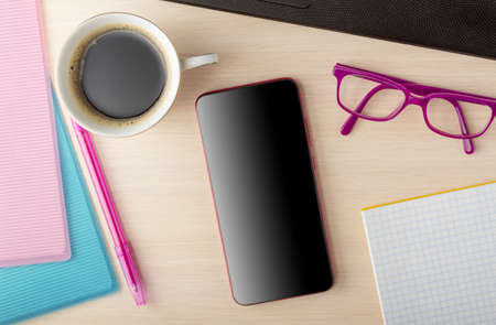Business concept. Top view. Folders with financial documents, invigorating coffee and gadgets, a phone for work