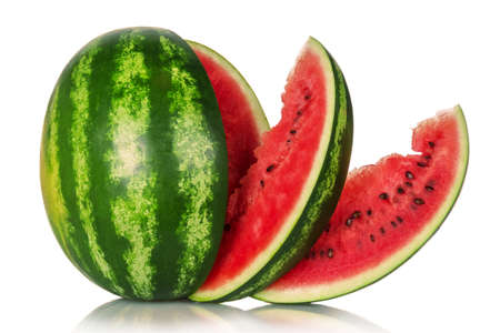Juicy tasty watermelon and several slices isolated on white background