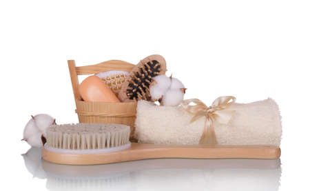 SPA concept. Body brush, soft towel, soap isolated on white background