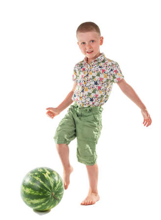 Concept. Happy boy playing watermelon soccer isolated on white background