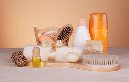 SPA set. Body brush, scented soap, massage oil, candle, skin care products Archivio Fotografico