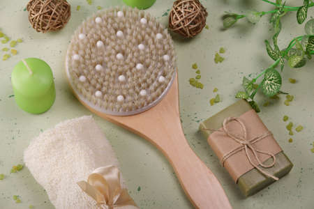 Body and skin care set. Body brush, bath salt, handmade soap. Top view