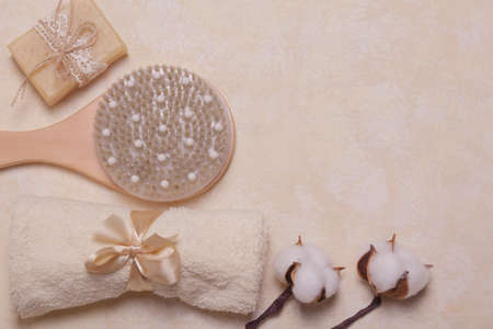 Top view. Bath set of towels, body brushes, handmade soap on a light background