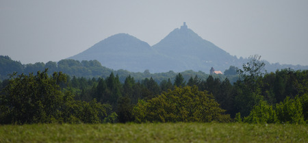 the distance: Castle Bezdez with two hills from distance Stock Photo