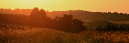 Orange sunset near village Tisa in north Bohemia summer