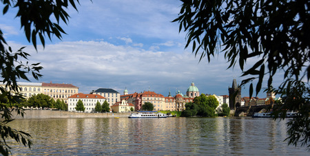 Vltava river with boats and bridges in summer Stock Photo