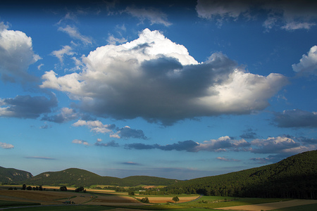 Cloudy evening in Austria countryside in hot summer Stock Photo