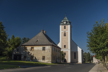 Big church tower in Kovarska village in summer evening