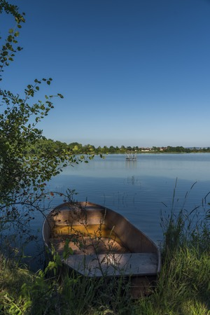 Boat on pond in south of Bohemia in summer day