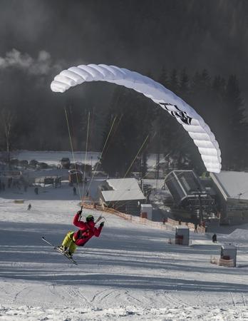 Paragliding in Dolni Morava ski slope in winter snow sunny day