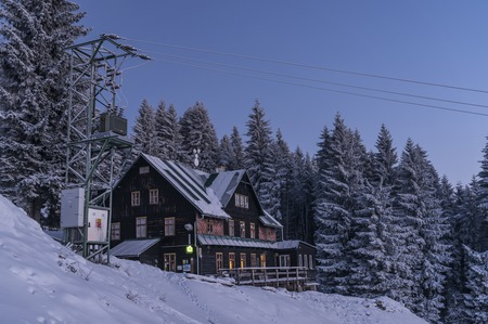 Navrsi cottage before sunrise in winter time