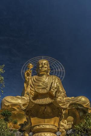 lat: Gold statue of sitting Buddha in Da Lat city
