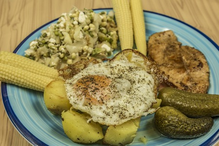 Chicken meat with potatoes and egg and vinegar vegetable