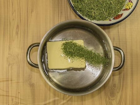 Medical marijuana leafs butter cooking with water