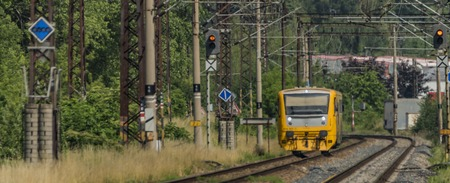 nad: Yellow and orange small train near Kostov station Stock Photo