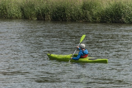 highlander: Green kayak on Dunajec river with passangers in summer day