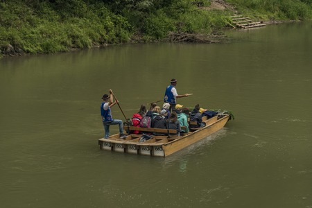 Wooden boats with passengers on Dunajec river in cold summer day 写真素材