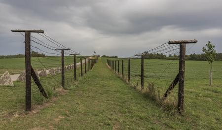 Old army road near Cizov village with roadblock and wires in national park Podyji