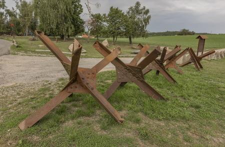 znojemsko: Old army road near Cizov village with roadblock and wires in national park Podyji