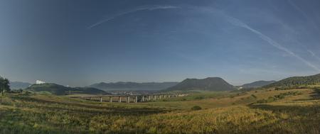 ruzomberok: Panorama view near Ruzomberok town with highway bridge and sunrise