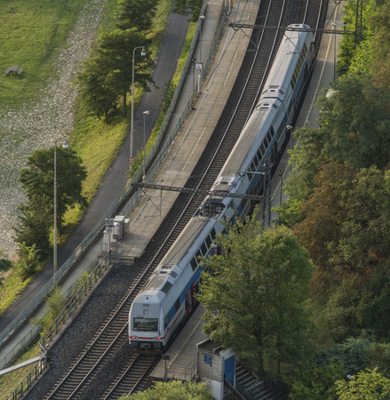 peron: Electric double deck train in valley of river Vltava