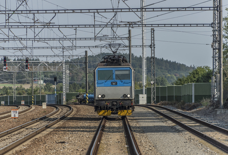 peron: Trains in Olbramovice station with sunlight platforms