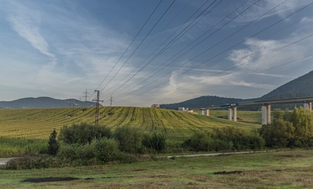 View near Ruzomberok town with big hill and electric wires in sunrise time Stock Photo