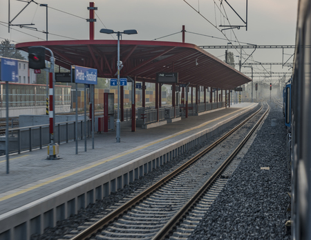 peron: Fast train from Prague to south of Bohemia with sunrise and morning fog Stock Photo