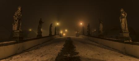 Night on baroque bridge with fog in winter Namest nad Oslavou town Reklamní fotografie
