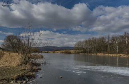 Pond with ice on Strizak hill in Usti nad Labem city