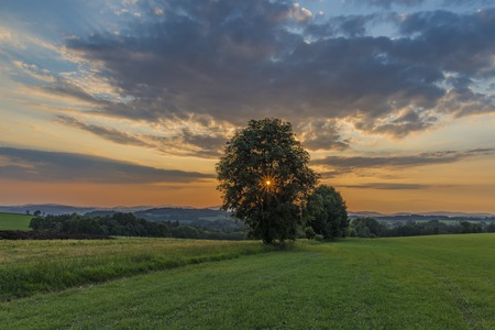 Color sunset near Roprachtice village in spring nice sunny evening Stock Photo