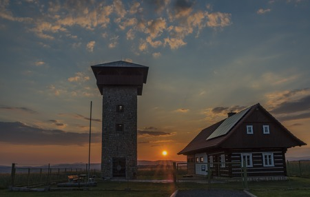 Color sunset near Roprachtice village in spring nice sunny evening with observation tower