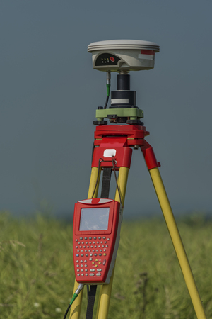 GPS tools in nettle field in hot summer in south Bohemia