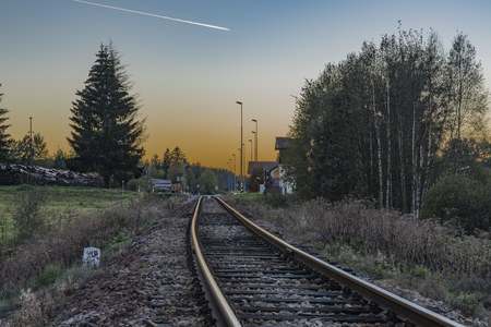 Railroad track near Zbytiny station in sunset time in Sumava national park Reklamní fotografie